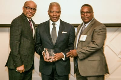 Leadership Award honoree, Ronald L. Walker II, accepts award next to colleague Robert Lewis Jr., and Maurice Jenkins, EVP Development, Chief Development Officer, UNCF
