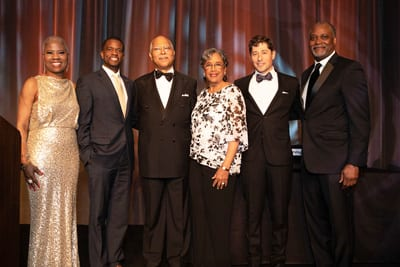 Honorees Cornell and Wenda Moore, with mayors and Michael Cox
