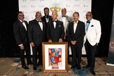 Omicron Boule with honoree Cornell Moore