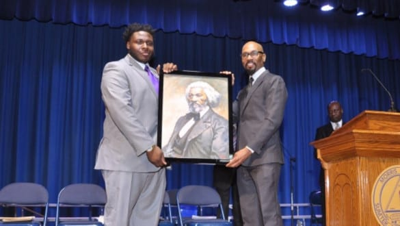 Alan Philip-Eon Johnson III receiving award