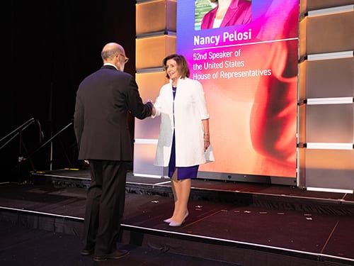 UNCF's President and CEO Dr. Michael Lomax greets Speaker Nancy Pelosi.
