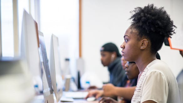 Female Claflin student sitting at a computer