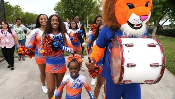 FMU mascot and cheerleaders