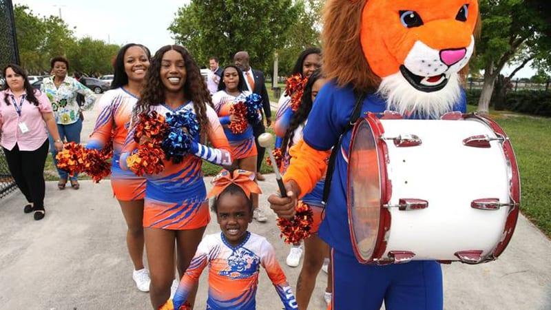 FMU mascot and cheerleaders