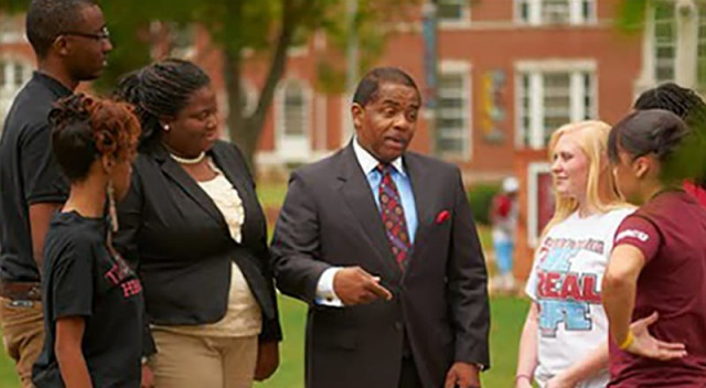 Billy Hawkins talks to students on campus at Talladega College