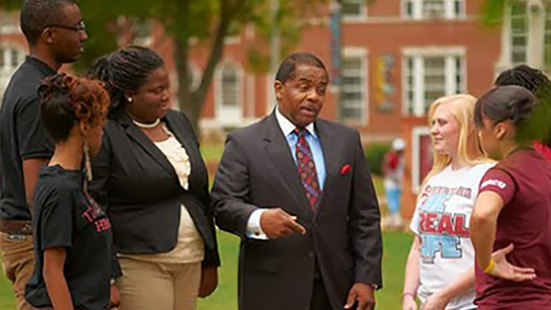 Dr. Billy Hawkins talks to students on the Talladega College campus.
