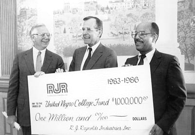 Pres. Bush with R.J. Reynolds executive and Chris Edley, Sr. accepting a $1 million gift, payable over three years (1983-1986).
