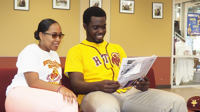 Male and female students at Houston-Tillotson studying together