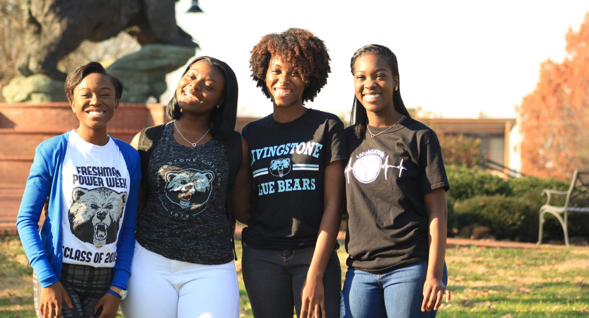 4 female Livingstone College students outside smiling