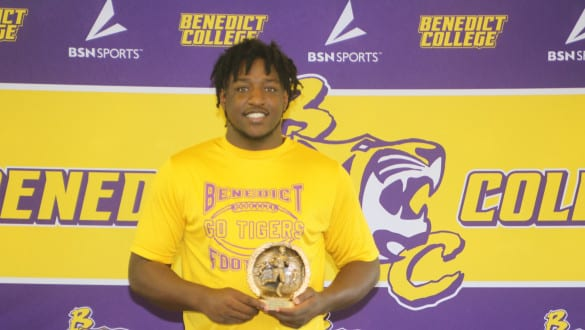 Keivonte Gallmon holding first place trophy for NCAA Football eSports competition
