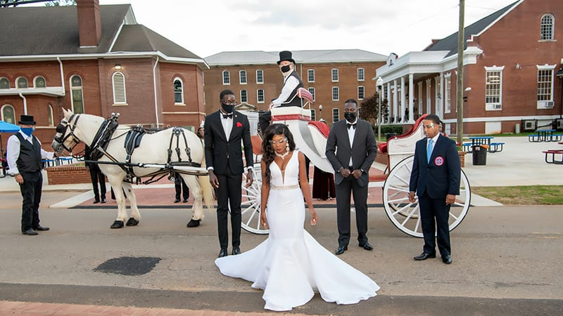 Miss Talladega arriving at the coronation on horse drawn carriage
