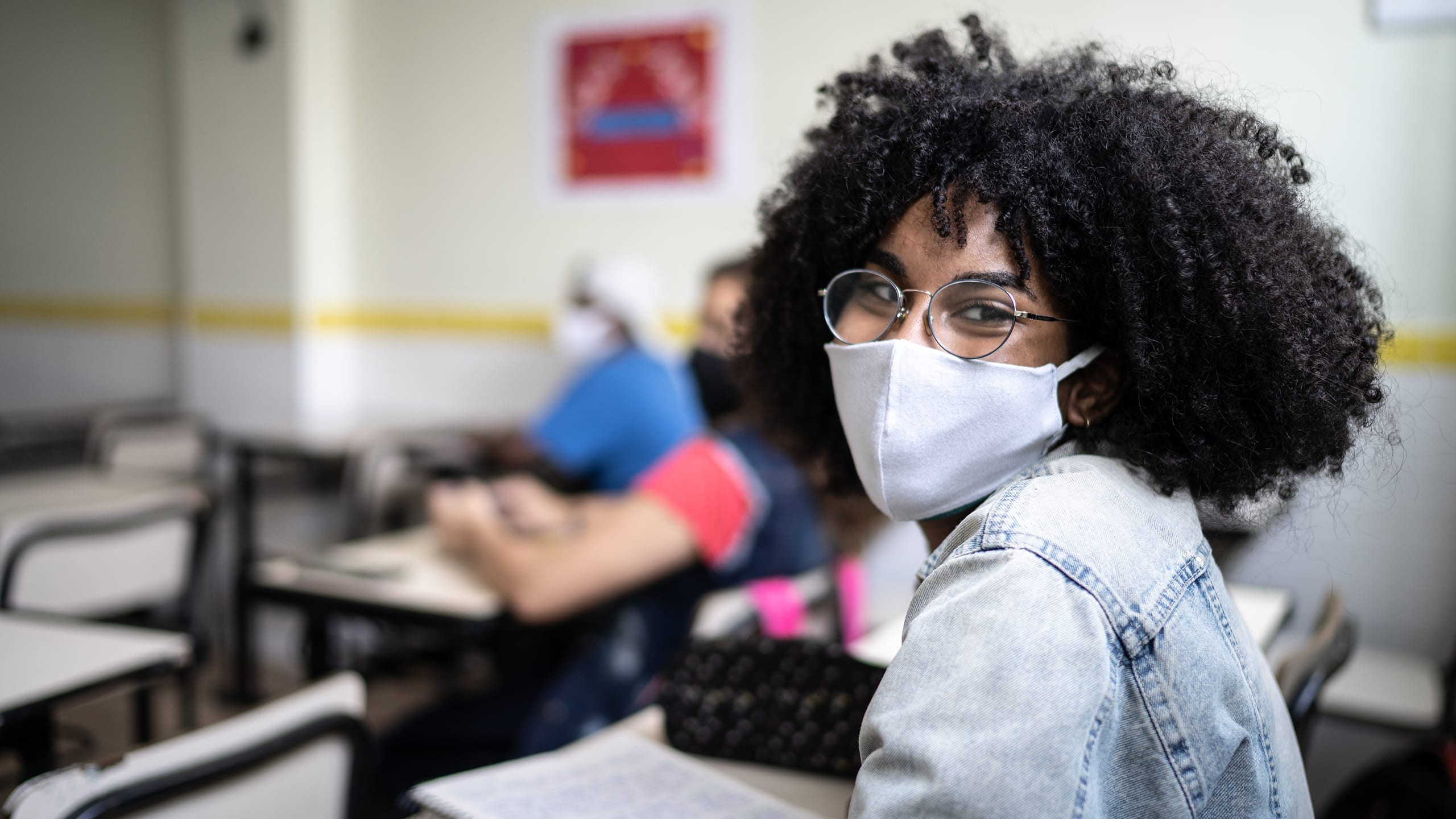 Hero banner image of female student wearing a mask