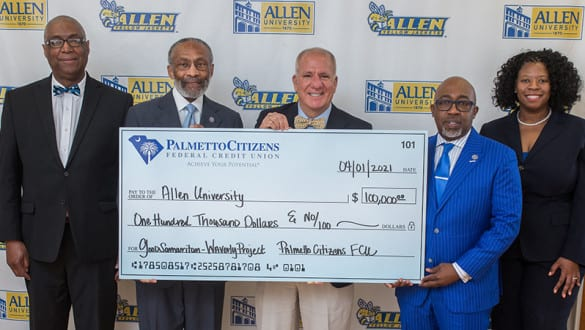 A group of Allen University officals recieve a $100,000 donation from Palmetto Federal Credit Union