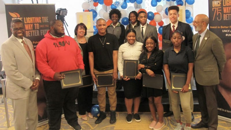 Larry A. Griffith, Dr. Michael L. Lomax and several UNCF scholarship recipients.