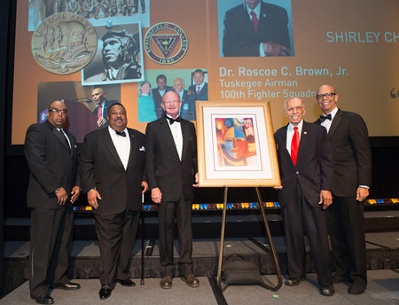 Dr. Brown (second from right) receiving his award on stage