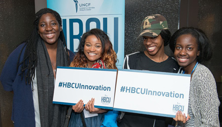 4 UNCF HBCU Innovation Summit participants with social media banners