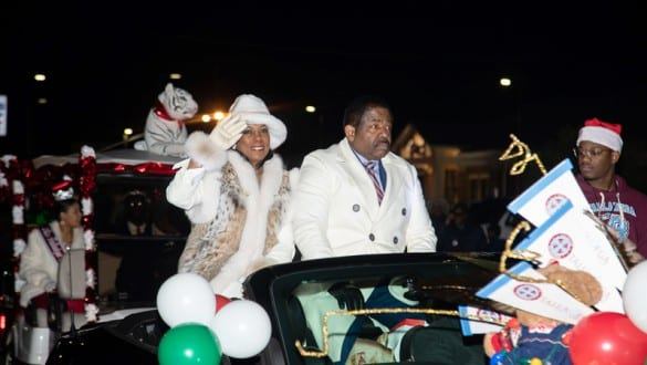 Billy Hawkins and Wife riding during Christmas parade in Talladega