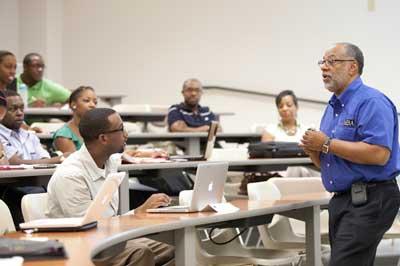 Professor speaking to students in clark atlanta University classroom