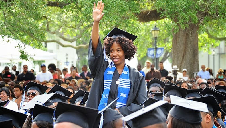 Group of graduates of Dillard University in caps and gowns