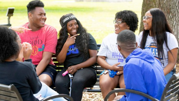 6 Dillard University students talking together outside on campus