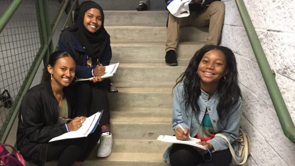 Students smiling on stairs