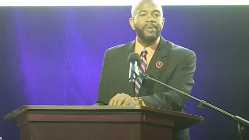 Dr. A. Zachary Faison, Jr., at podium
