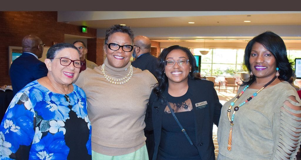Group shot of four female UNCF alumni