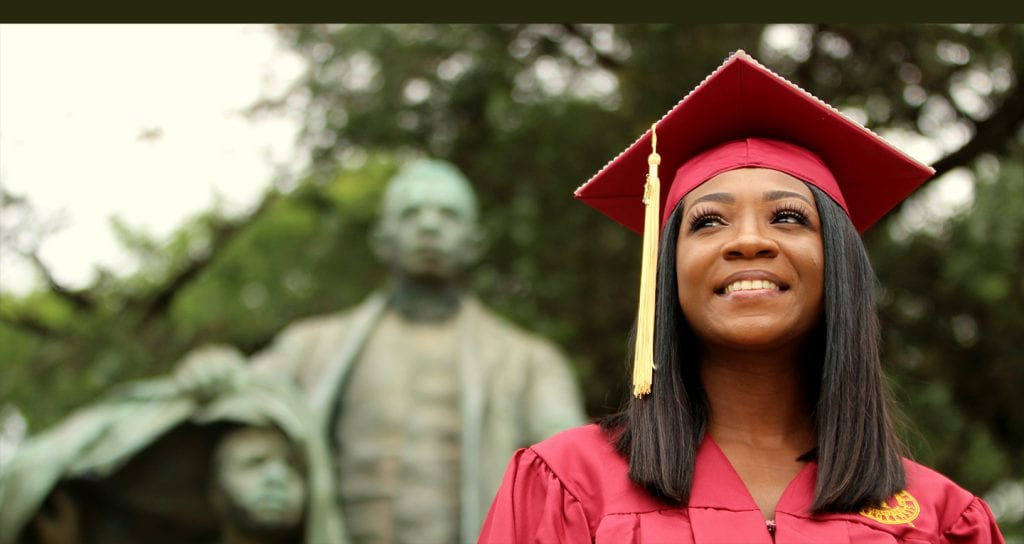 Tuskegee University female graduate wearing cap and gown