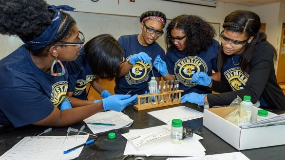 5 female students working with laboratory equipment at Xavier University of Louisiana