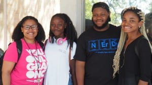 4 Huston Tillotson University students smiling on campus