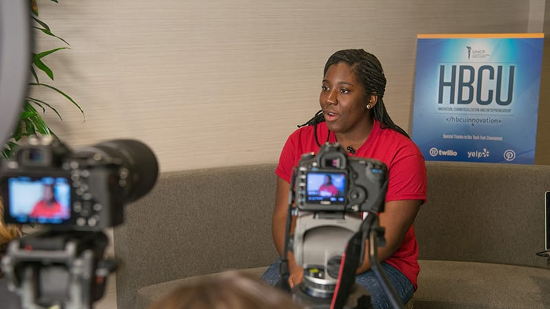 UNCF female student speaking to camera during HBCU Innovation Summit