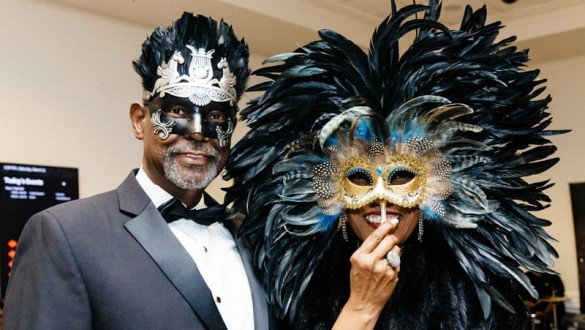Attendees wearing masks at an UNCF Mayor's Masked Ball