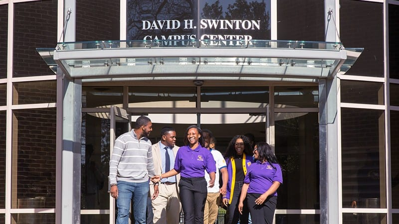 Benedict College building with students walking out of it