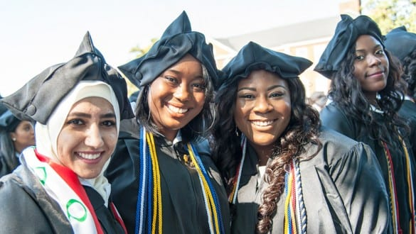 Female students from Bennett College wearing caps and gowns during graduation ceremony