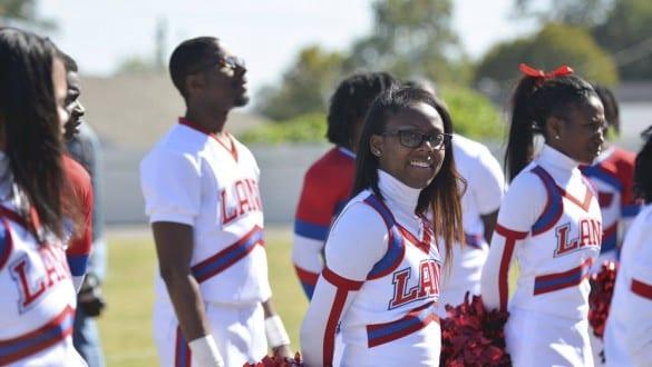 Group shot of Lane College cheerleaders in uniform on field