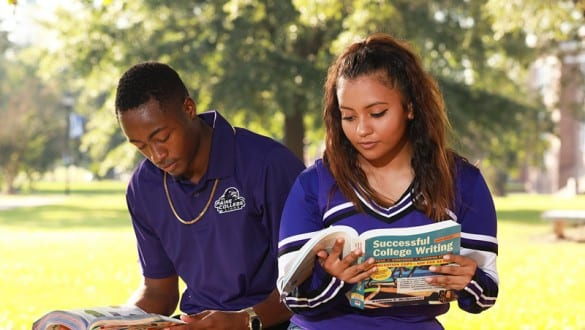 2 Paine College students reading outside on campus