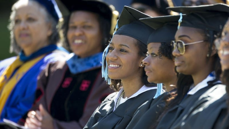 Graduating students and faculty from Spelman College wearing caps and gowns during graduation ceremony