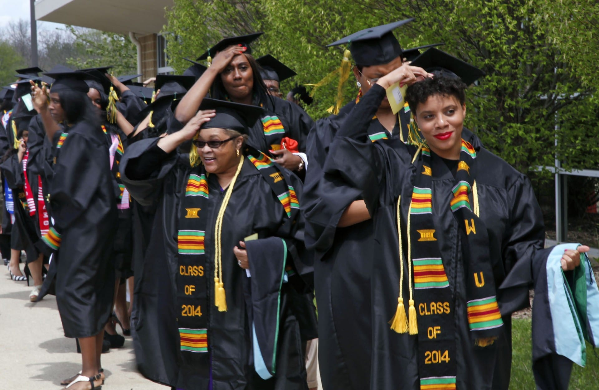 Group shot of Wilberforce University students wearing caps and gowns lined up for a graduation ceremony