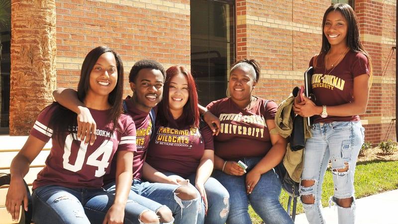 Group shot of Bethune Cookman University students smiling outside