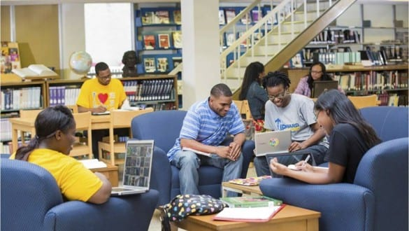 Group shot of Jarvis Christian College students studying with laptops in library