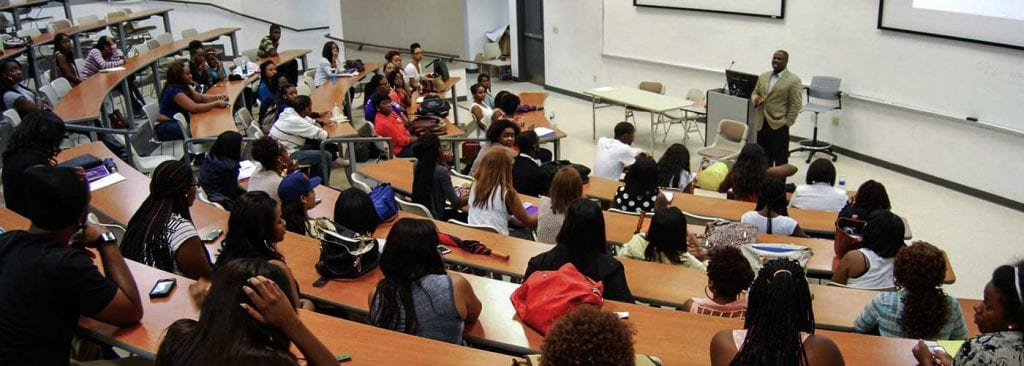 Professor speaks to lecture hall full of college students