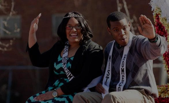 Paine College homecoming king and queen wave to crowd during parade