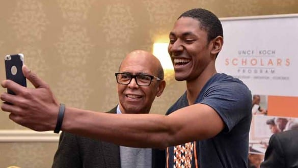 Male UNCF Koch Scholars Program student and Michael Lomax taking selfie