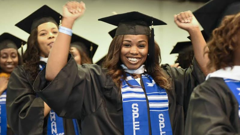 Graduates cheering during ceremonies at Spelman College