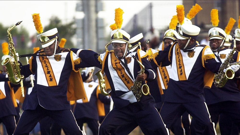 Stillman College marching band members performing during football game