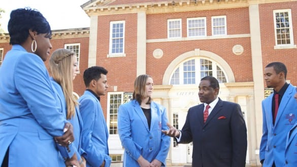 Group shot of Talladega College students wearing blue blazers outside a building on campus
