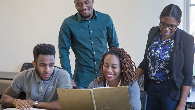 4 students studying in classroom at Talladega College