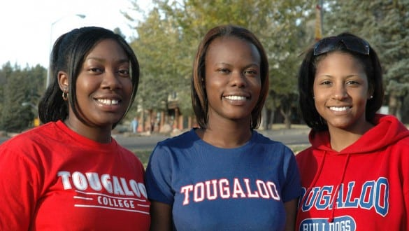 Group shot of 3 Tougaloo College girls smiling