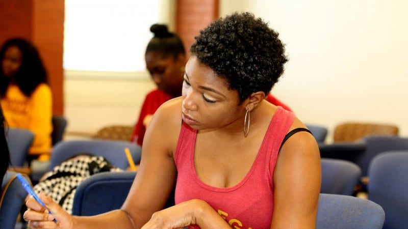 Female Tuskegee University students studying in classroom