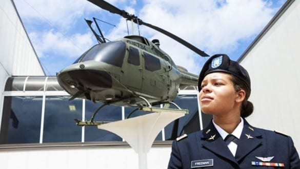 Headshot of Kayla Freeman and helicopter at Tuskegee University